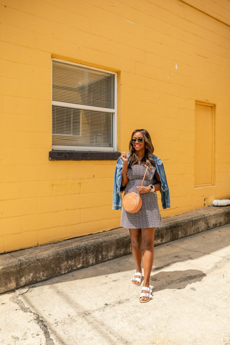 How to Style a Little Black Dress | Scoop Dress by popular D.C. fashion blogger, Alicia Tenise: image of of Alicia Tenise wearing a Walmart Scoop Women's Ruffle Sleeve Shift Dress, Time and Tru Women's Denim Jacket, and Walmart Women's Birkenstock Arizona Birko-Flor Sandal.