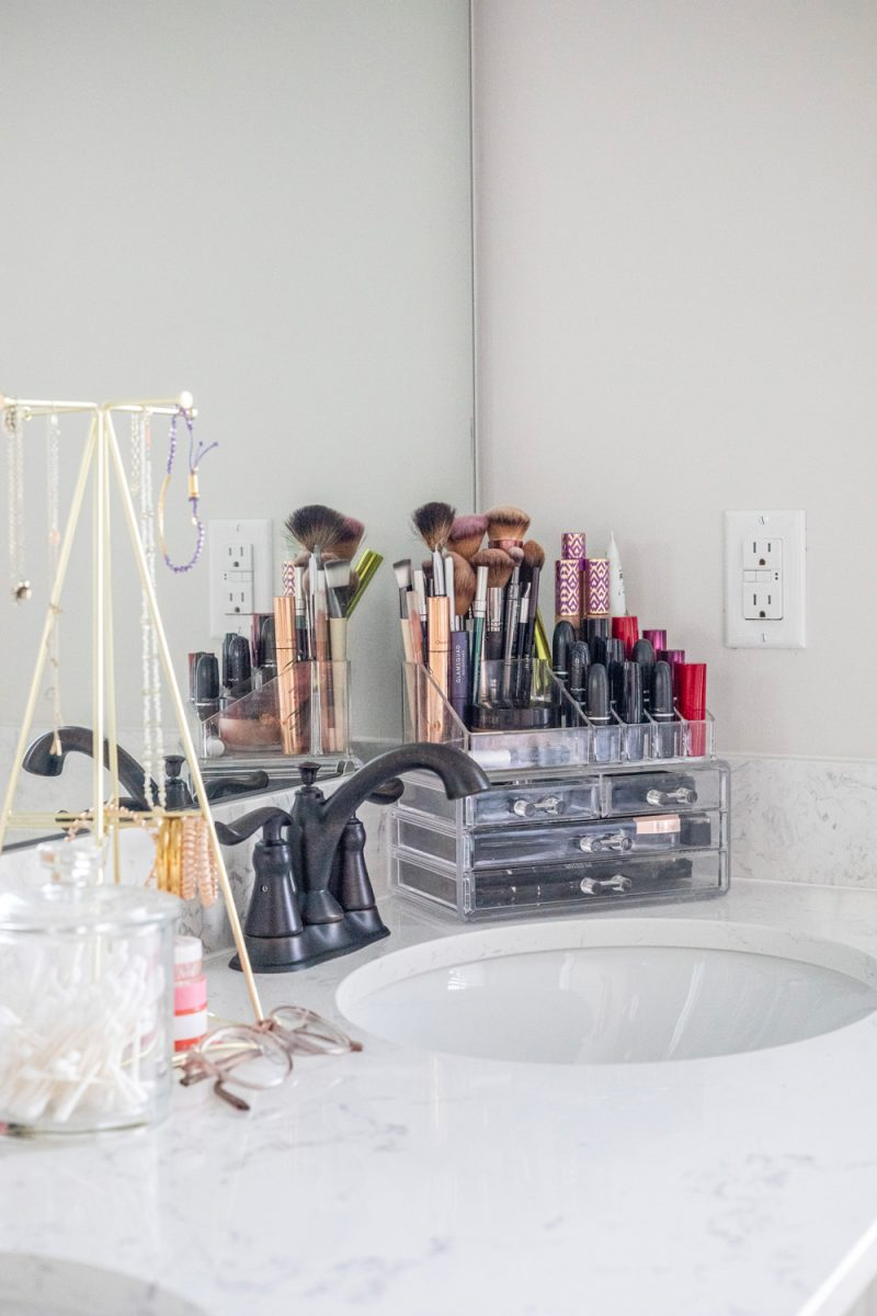 Master Bathroom by popular D.C. life and style blogger, Alicia Tenise: image of a master bathroom vanity counter top with acrylic organizers and storage compartments.