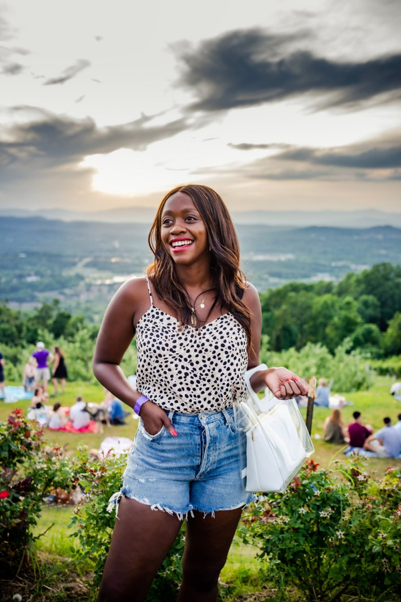 AGOLDE Dee Ultra High-Rise Denim Shorts | AGOLDE Jeans by popular D.C. fashion blogger, Alicia Tenise: image of Alicia Tenise wearing a leopard print spaghetti strap top and pair of Anthropologie AGOLDE Parker Ultra High-Rise Denim Shorts.