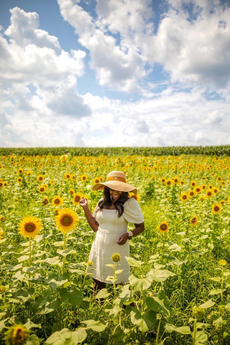Abercrombie Puff-Sleeve Linen-Blend Mini Dress | Being 30 by popular D.C. lifestyle blogger, Alicia Tenise: image of Alicia Tenise standing in a sunflower field and wearing a Hat Attack Coco Sunhat and Abercrombie and Fitch Puff-Sleeve Linen-Blend Mini Dress.