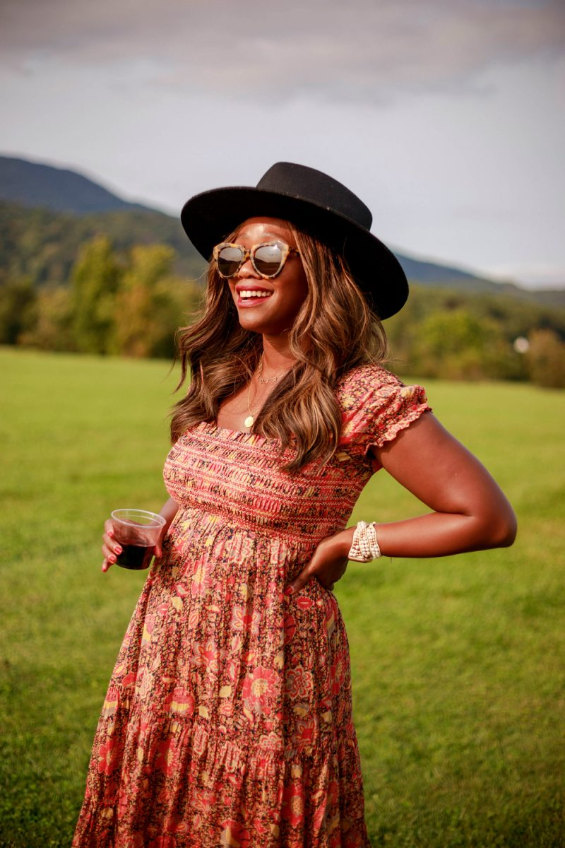 Karen Walker Number One Sunglasses, Lack of Color Benson Tri - Black | What to Wear to a Winery by popular D.C. fashion blogger, Alicia Tenise: image of Alicia Tenise standing outside at at winery and wearing a Free People Getaway Midi Dress and Lack of Color Benson Tri hat.