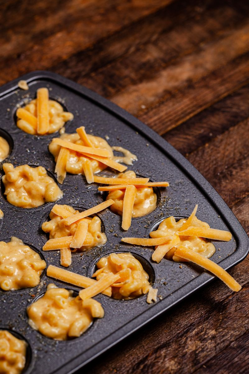 Mac and Cheese Bites by popular D.C. food blog, Alicia Tenise: image of a mini muffin tin filled with mac and cheese bites.