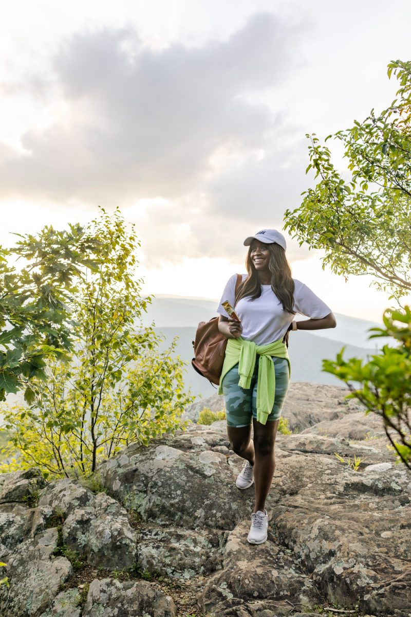 Camo Bike Shorts, Blue Ridge Mountains | High Functioning Depression by popular D.C. lifestyle blogger, Alicia Tenise: image of a woman hiking in the mountains and wearing a pair of camo biker shorts, white t-shirt, and white baseball hat.