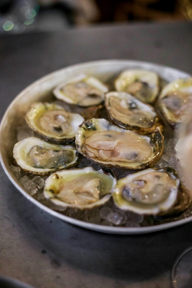 H&F Burger | Things to do in Asheville NC by popular D.C. travel blogger, Alicia Tenise: image of a plate of oysters.