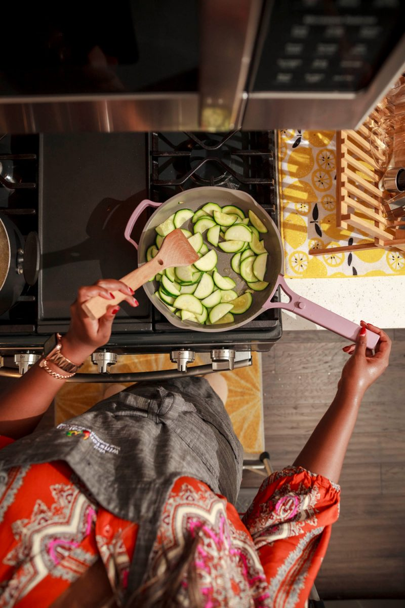 Blue Apron Review by popular D.C. food blogger, Alicia Tenise: image of Alicia Tenise cooking some zucchini on her gas range stove top.