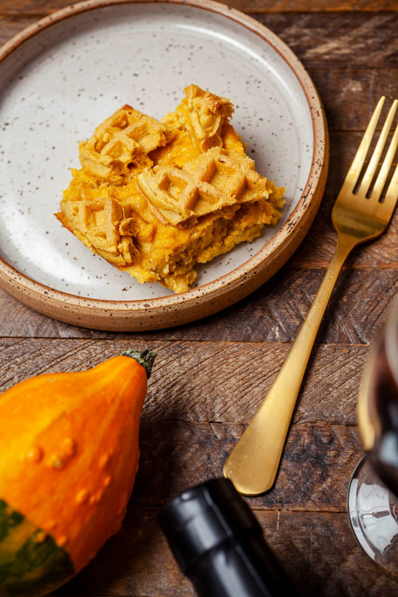 Pumpkin Waffle Bread Pudding | Trader Joe's Pumpkin Waffle Bread Pudding Recipe | Trader Joe's Fall Recipe Ideas | Trader Joe's Wine by popular D.C. lifestyle blogger, Alicia Tenise: image of pumpkin waffle bread pudding, mini pumpkins, cloth napkins, candle votive, and a bottle of red wine.