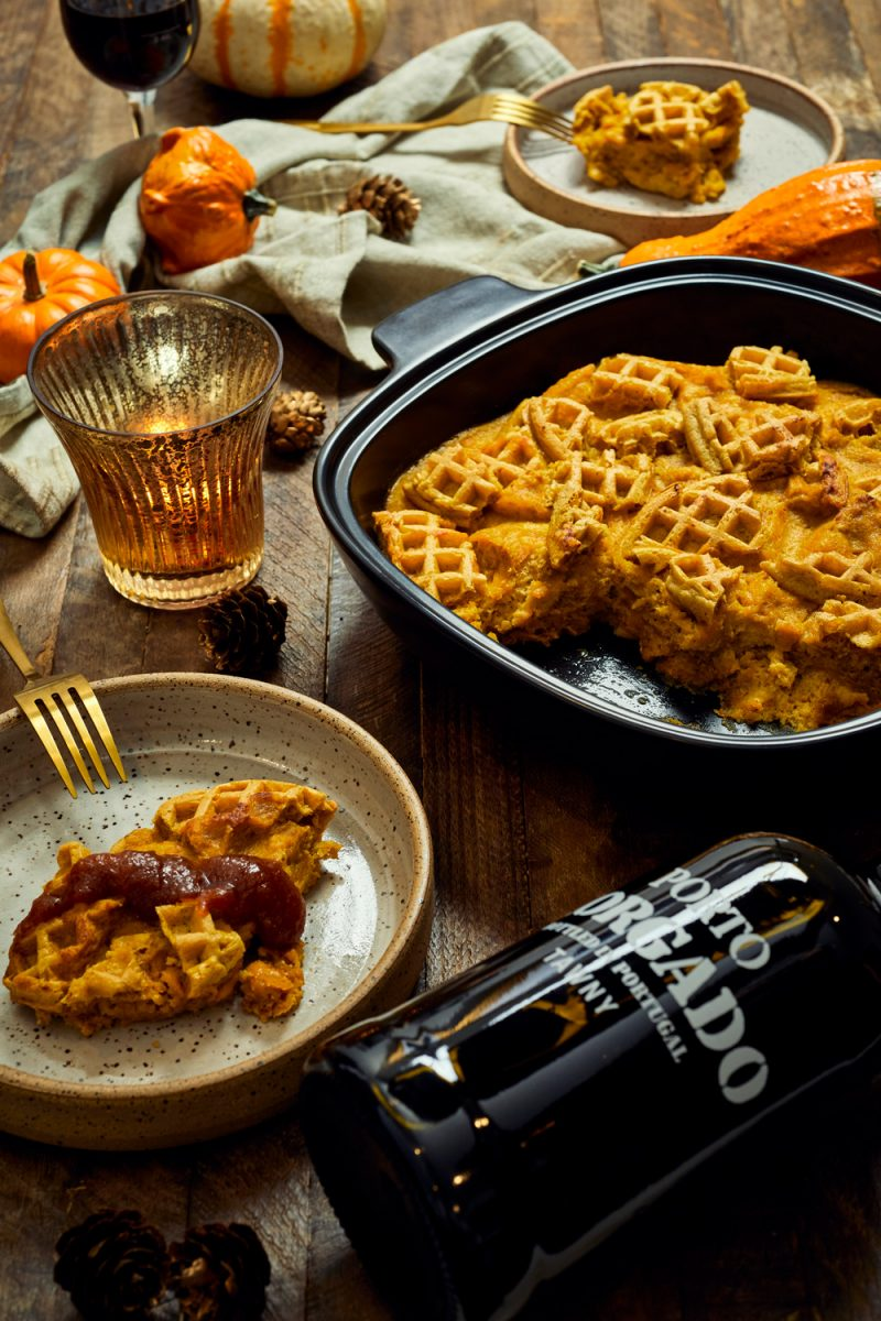 Trader Joe's Pumpkin Waffle Bread Pudding Recipe | Trader Joe's Fall Recipe Ideas | Trader Joe's Wine by popular D.C. lifestyle blogger, Alicia Tenise: image of pumpkin waffle bread pudding, mini pumpkins, cloth napkins, candle votive, and a bottle of red wine.