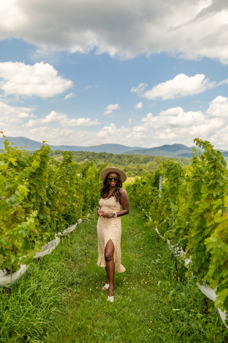 Stinson Vineyards |Things to do in Charlottesville by popular D.C. travel blog, Alicia Tenise: image of Alicia Tenise at Stinson Vineyards.