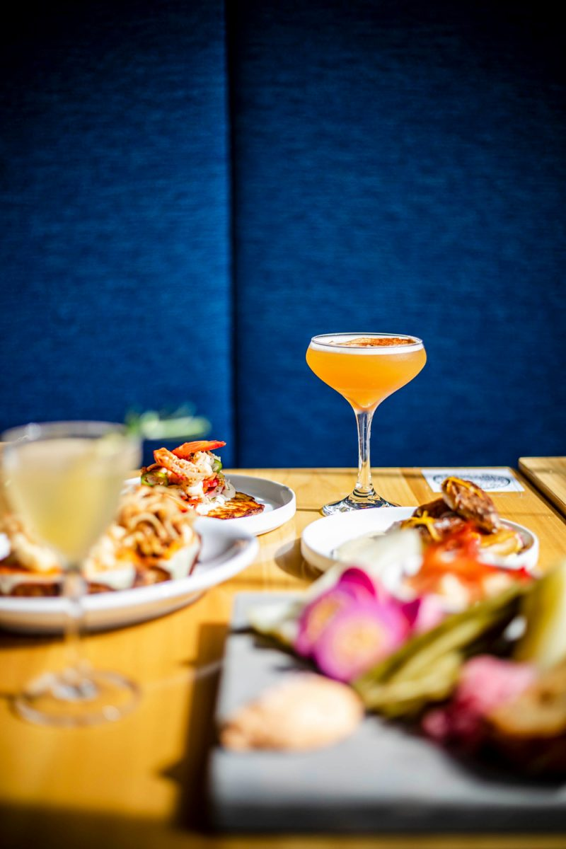 Tonic Charlottesville  |Things to do in Charlottesville by popular D.C. travel blog, Alicia Tenise: image of a table set with food and drinks at Tonic restaurant.