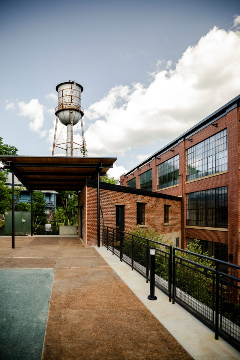 Things to do in Charlottesville by popular D.C. travel blog, Alicia Tenise: image of a Charlottesville building and water tower.