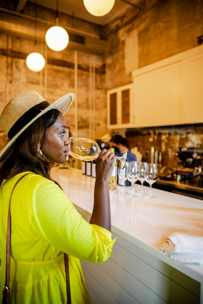 Wine Tasting in Charlottesville |Things to do in Charlottesville by popular D.C. travel blog, Alicia Tenise: image of Alicia Tenise at a Charlottesville wine tasting.