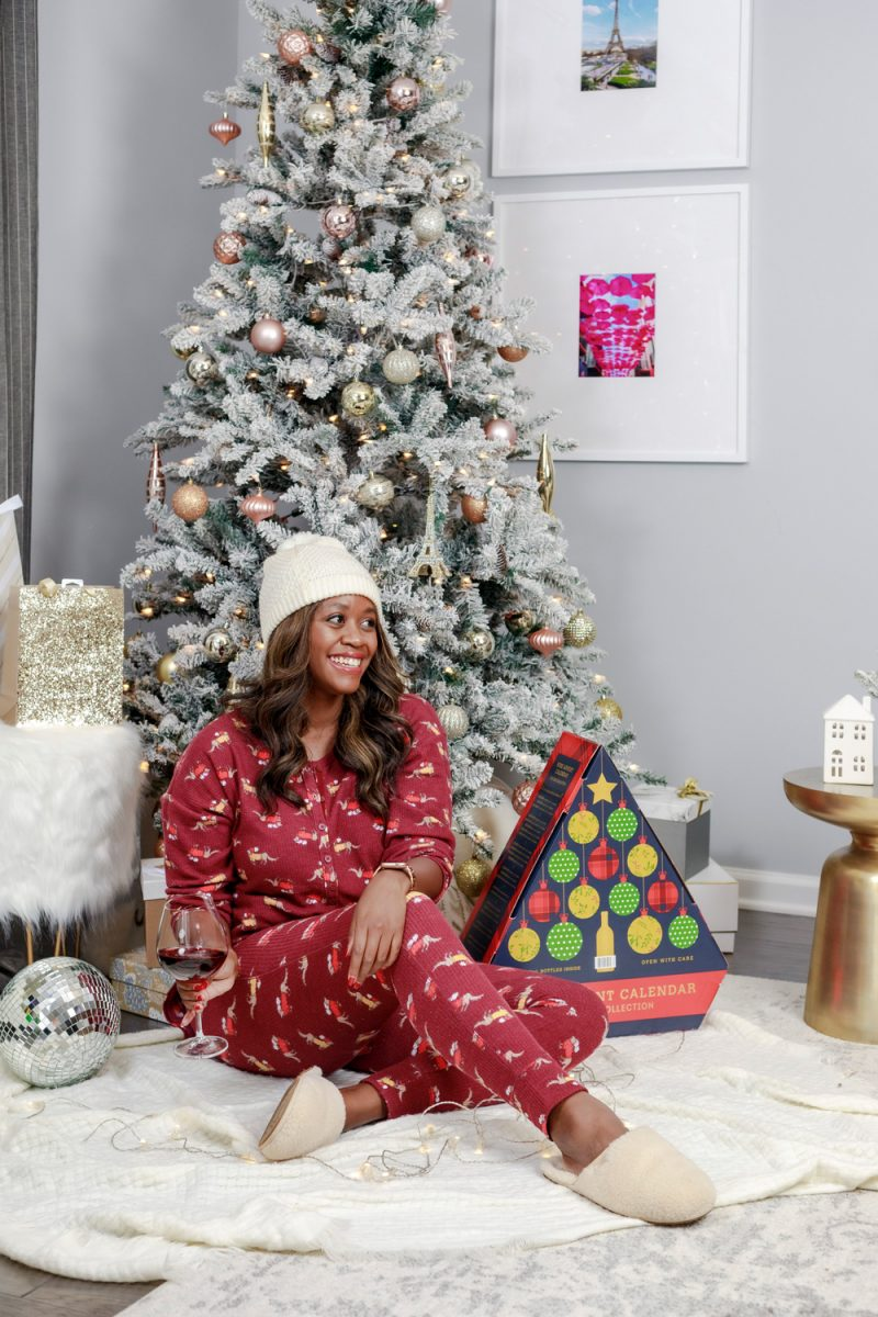 Aerie Waffle Long Sleeve Pajama Shirt and Waffle Pajama Legging |Christmas Morning Pajamas by popular D.C. fashion blogger, Alicia Tenise: image of a Alicia Tenise sitting in front of a flocked Christmas tree and next to a wine advent calendar while wearing a Aerie Waffle Long Sleeve Pajama Shirt, Aerie Waffle Pajama Legging and Ugg Fluffette Slipper.