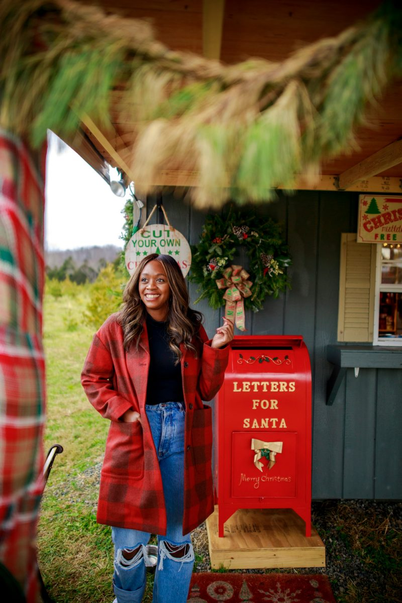 Walmart Free Assembly Women's Cocoon Coat |Walmart Free Assembly by popular D.C. fashion blogger, Alicia Tenise: image of Alicia Tenise standing outside at a Christmas tree farm and wearing a Free Assembly red plaid cocoon coat, distressed denim, and black turtleneck shirt.