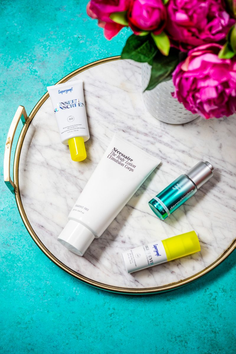 Skincare Products by popular D.C. beauty blogger, Alicia Tenise: image of Supergoop eye cream, Supergoop unseen suncreen, Necessaire lotion, and Dermalogica acne serum.