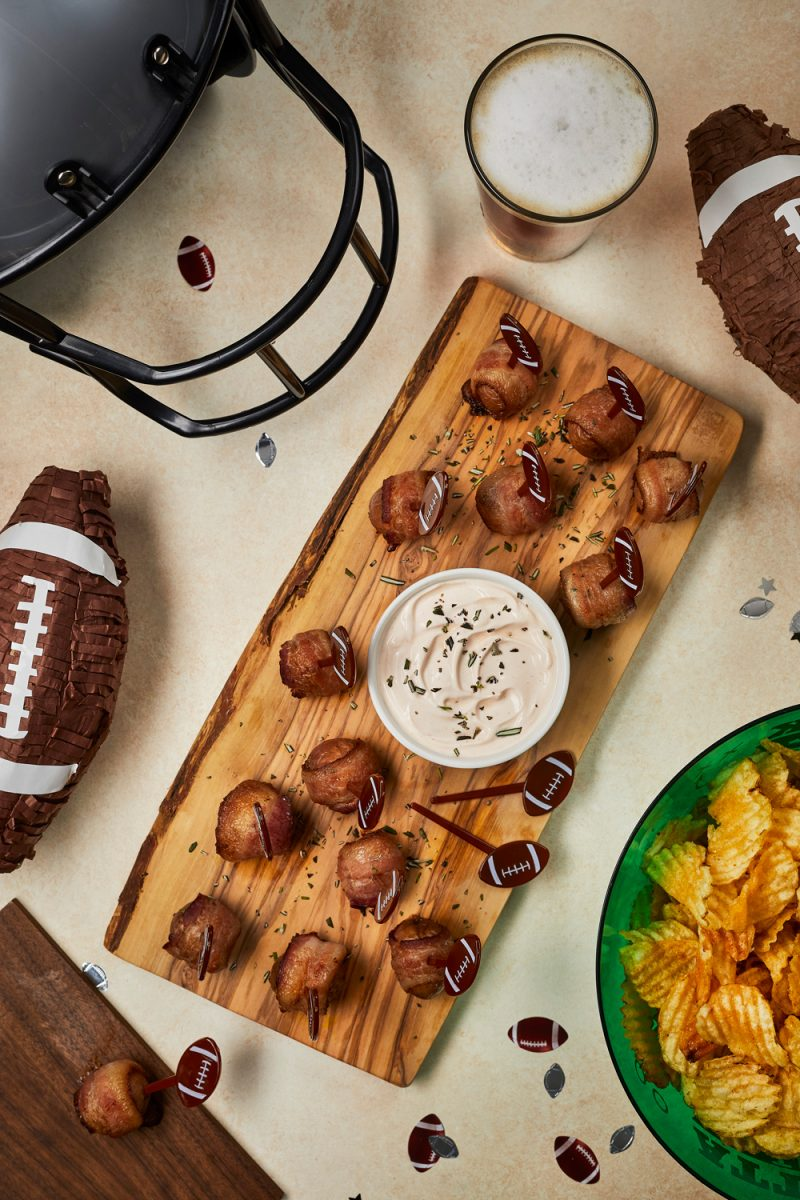 Bacon-Wrapped Potato Bites with Spicy Sour Cream Dipping Sauce |Football Party Ideas by popular D.C. lifestyle blogger, Alicia Tenise: image of bacon wrapped potato bites.