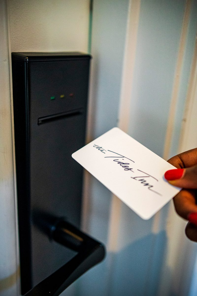 Tides Inn Room Key |Tides Inn in Irvington by popular D.C. travel blogger, Alicia Tenise: image of a woman holding a Tides Inn room key card.