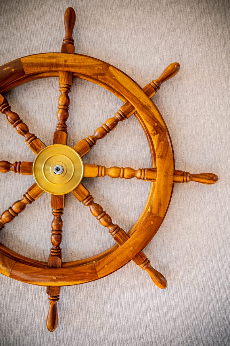 Tides Inn in Irvington by popular D.C. travel blogger, Alicia Tenise: image of a wooden ship steering wheel.