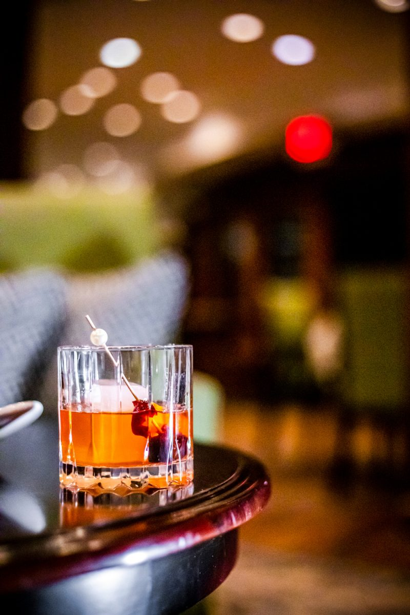 The Tides Inn Bourbon Tasting Experience |Tides Inn in Irvington by popular D.C. travel blogger, Alicia Tenise: image of a alcoholic drink.
