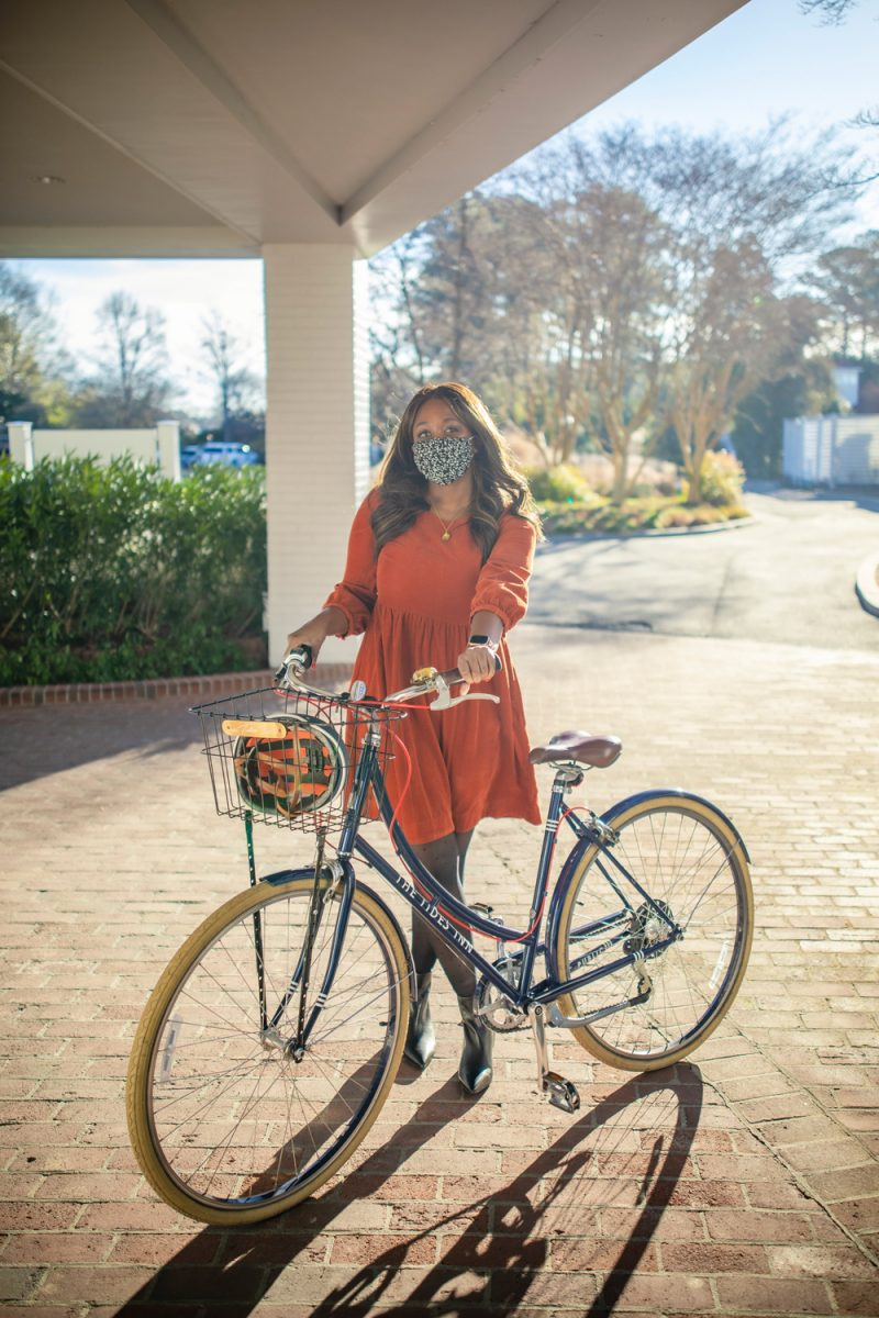 Bike Rentals at the Tides Inn, Madewell Corduroy Puff-Sleeve Mini Dress |Tides Inn in Irvington by popular D.C. travel blogger, Alicia Tenise: image of Alicia Tenise standing next to a beach cruiser bike.