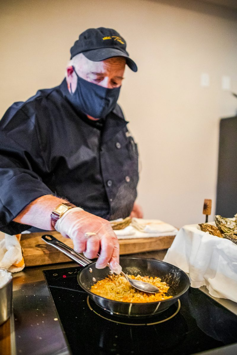 Chef's Kitchen Experience at the Tides Inn, Chef Pete Woods |Tides Inn in Irvington by popular D.C. travel blogger, Alicia Tenise: image of a chef cooking food.