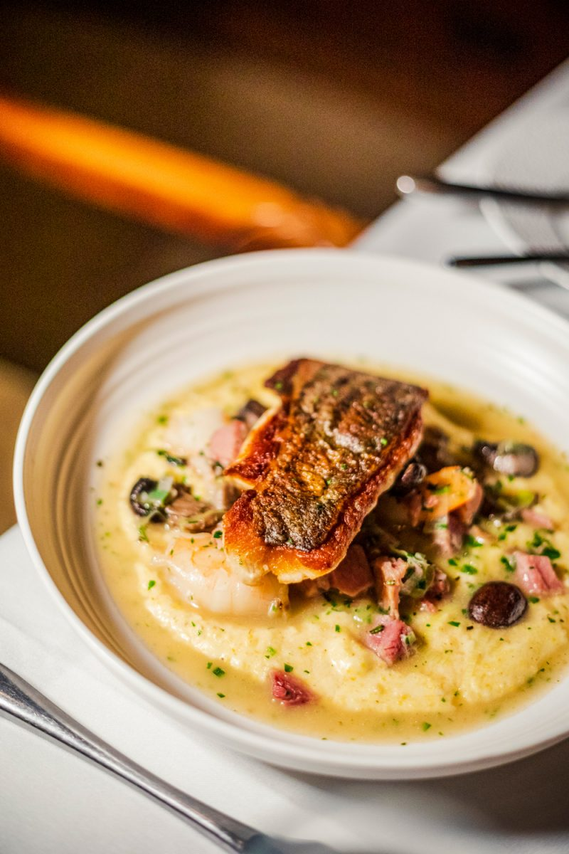 Rockfish at the Chesapeake Restaurant & Terrace |Tides Inn in Irvington by popular D.C. travel blogger, Alicia Tenise: image of a fish dish.