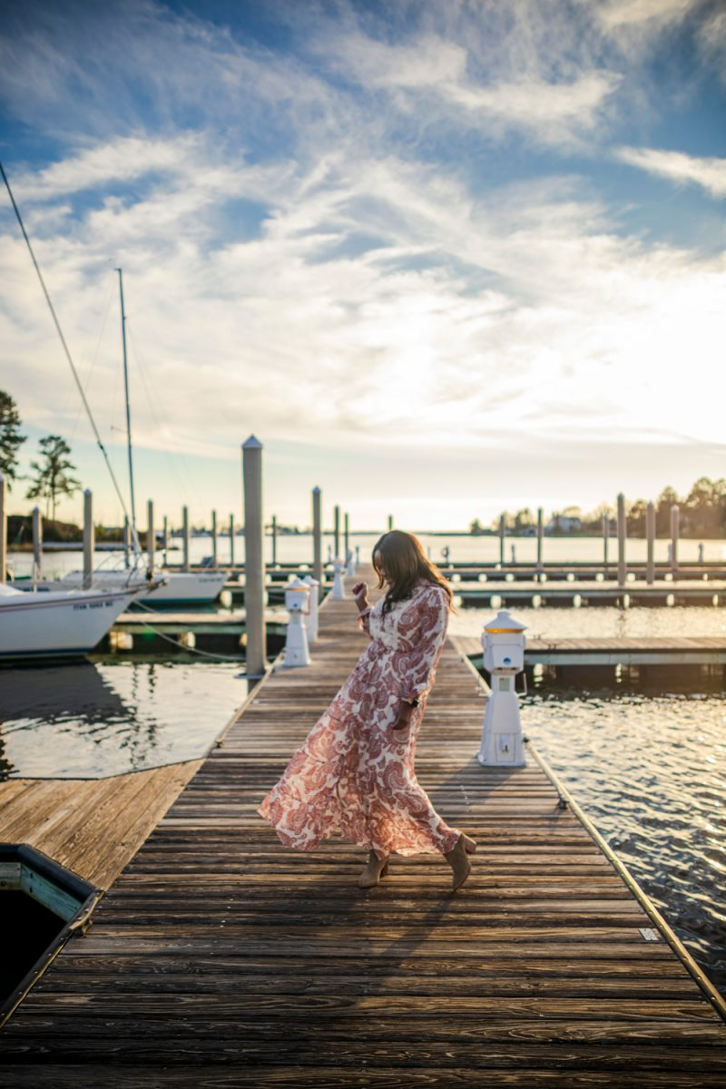 The Tides Inn Dock, Allaire Maxi Shirtdress |Tides Inn in Irvington by popular D.C. travel blogger, Alicia Tenise: image of Alicia Tenise wearing a Allaire Maxi shirt dress and standing on a boat dock.