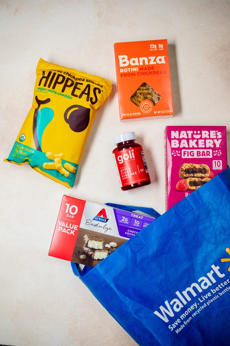 Walmart Wellness Hub |Walmart Wellness Hub by popular D.C. lifestyle blogger, Alicia Tenise: image of Hippeas, Goli gummies, Banza pasta, Nature's Bakery fig bar, Atkin's bars value pack and a reusable Walmart shopping bag.
