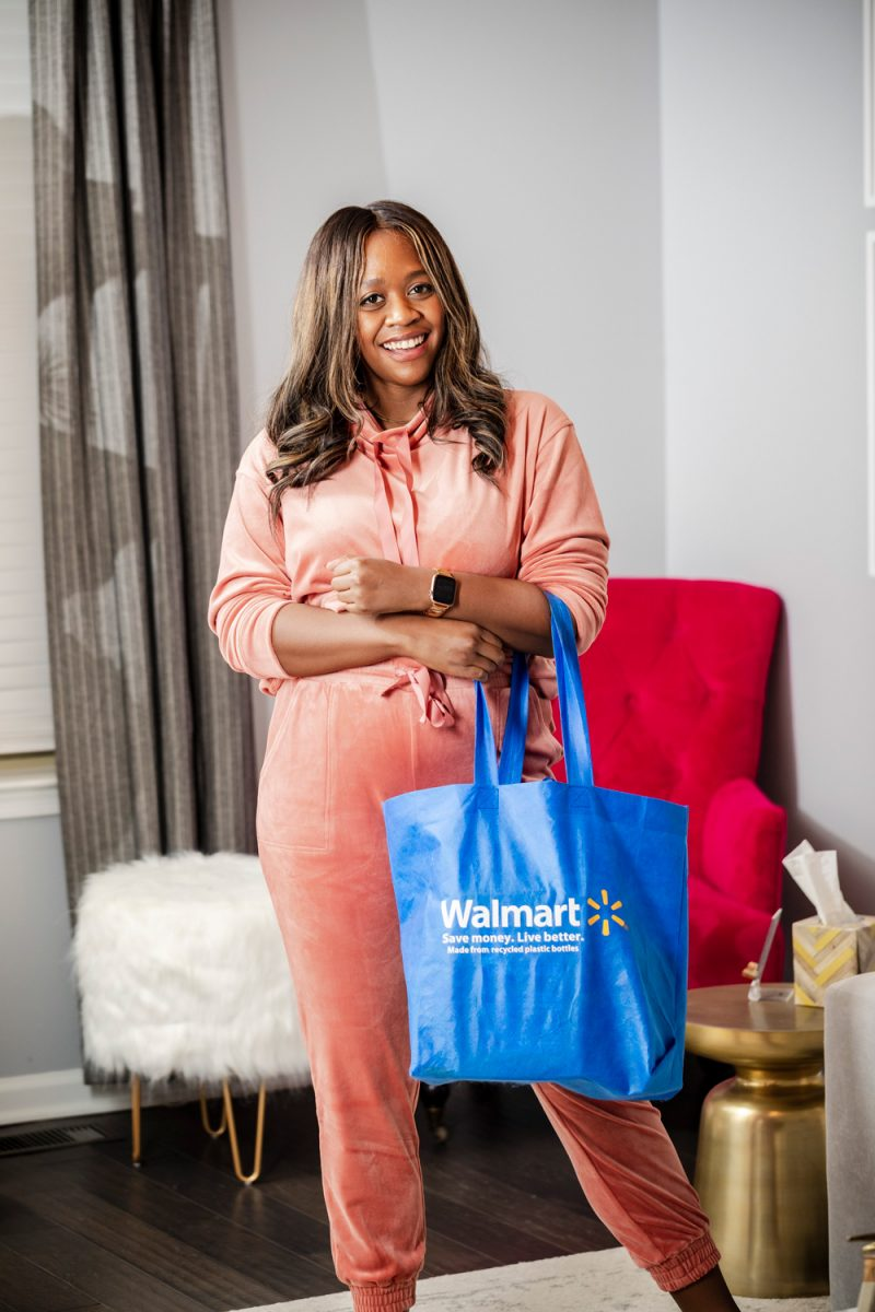 Walmart Wellness Hub Review |Walmart Wellness Hub by popular D.C. lifestyle blogger, Alicia Tenise: image of Alicia Tenise wearing a pink velour jogging suit and holding a reusable Walmart shopping bag.