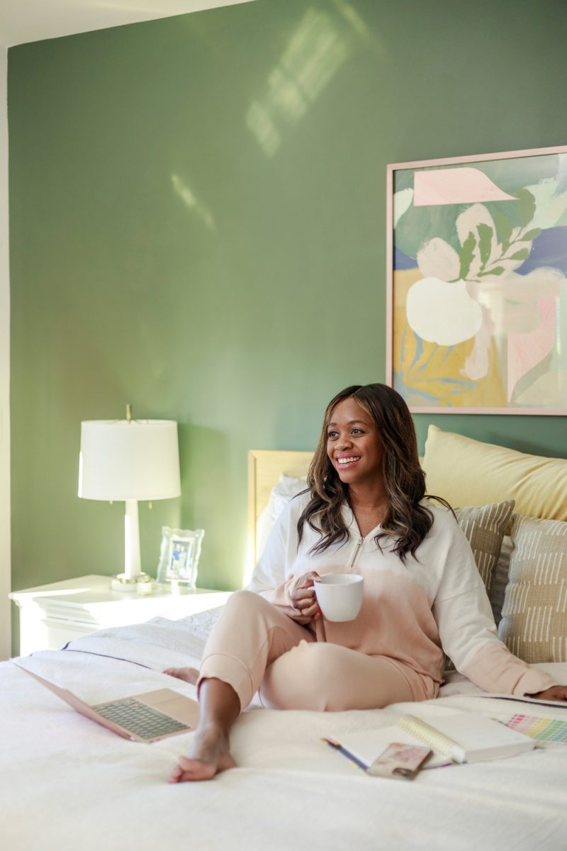 Aerie Fleece-Of-Mind Cropped Quarter Zip Hoodie, Aerie Fleece-Of-Mind Zip Jogger |Aerie Spring Loungewear by popular D.C. fashion blogger, Alicia Tenise: image of Alicia Tenise sitting in her bed and wearing a Aerie Fleece-Of-Mind Zip Jogger.