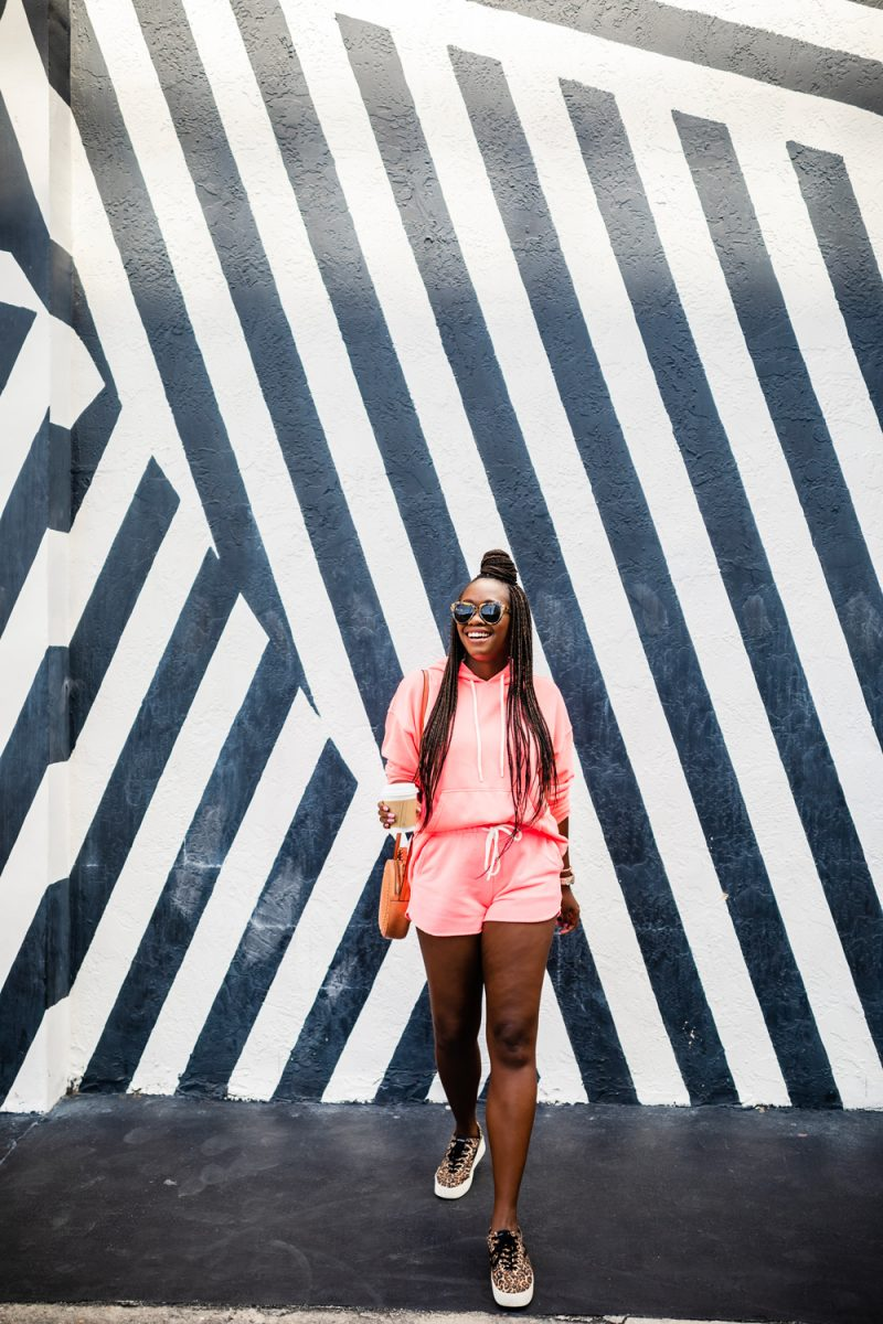 Wynwood Miami |Florida Keys Road Trip by popular D.C. travel blogger, Alicia Tenise: image of Alicia Tenise standing in front of a black and white stripe Wynwood Miami wall mural.