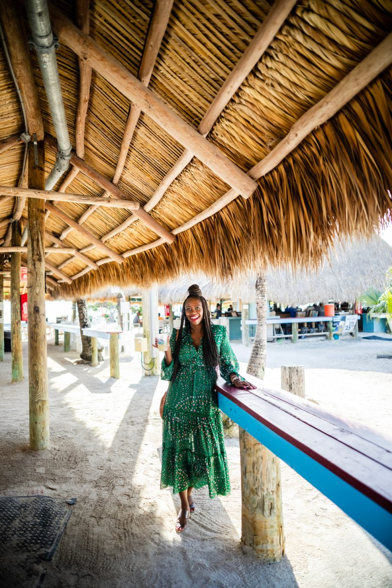 Gilbert's Key Largo |Florida Keys Road Trip by popular D.C. travel blogger, Alicia Tenise: image of Alicia Tenise wearing a green floral print maxi dress at Gilbert's Key Largo.