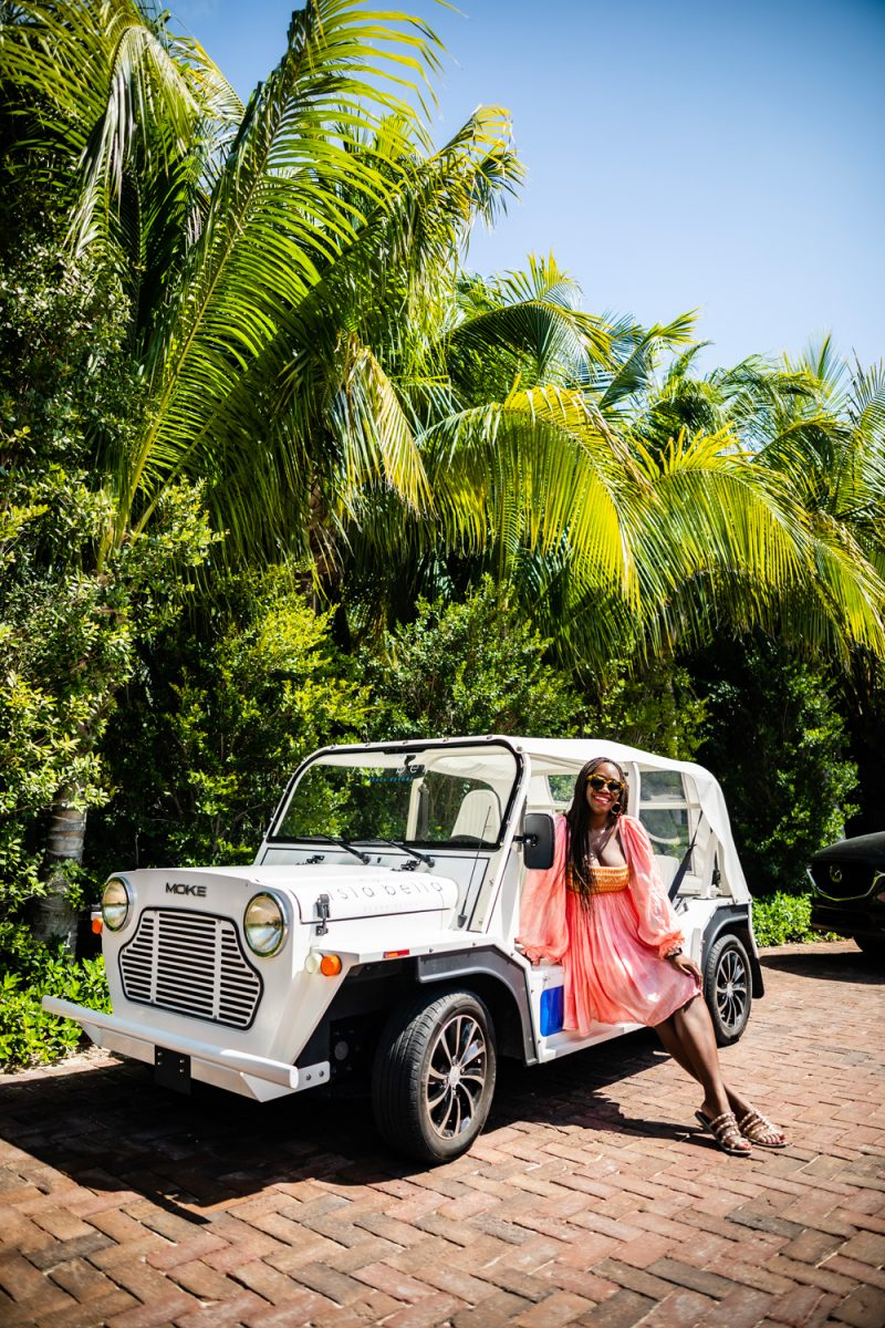 Isla Bella Resort Marathon Florida |Florida Keys Road Trip by popular D.C. travel blogger, Alicia Tenise: image of Alicia Tenise leaning against a white jeep parked next to some palm trees.