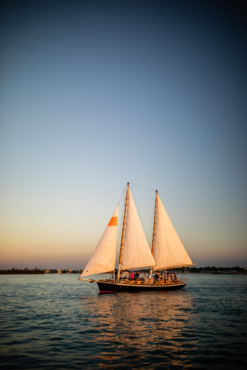 Key West Boat Cruise | Florida Keys Road Trip by popular D.C. travel blogger, Alicia Tenise: image of a sail boat out on the ocean.