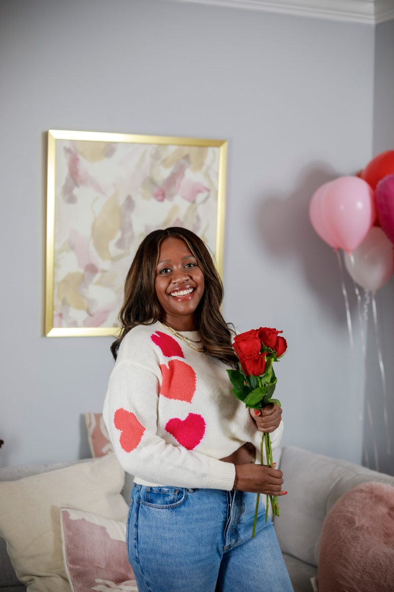 Lou & Grey Heart Sweater |Valentine's Day Outfit by popular D.C. fashion blogger, Alicia Tenise: image of Alicia Tenise holding some red roses and wearing a Lou & Grey heart print sweater.