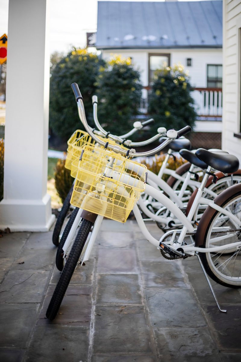 White Moose Inn Bicycles |Washington VA by popular D.C. travel blogger, Alicia Tenise: image of white bikes with yellow baskets.