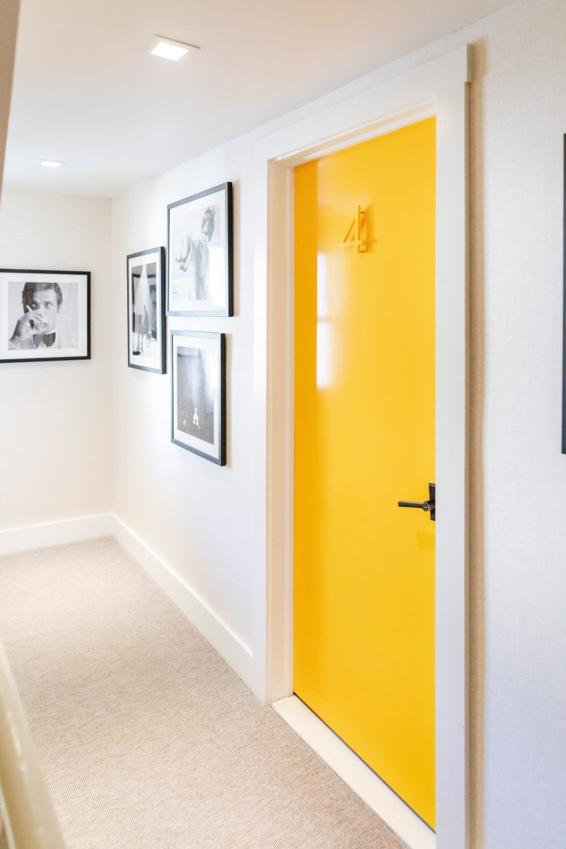 White Moose Inn in Washington VA |Washington VA by popular D.C. travel blogger, Alicia Tenise: image of a yellow hotel room door.