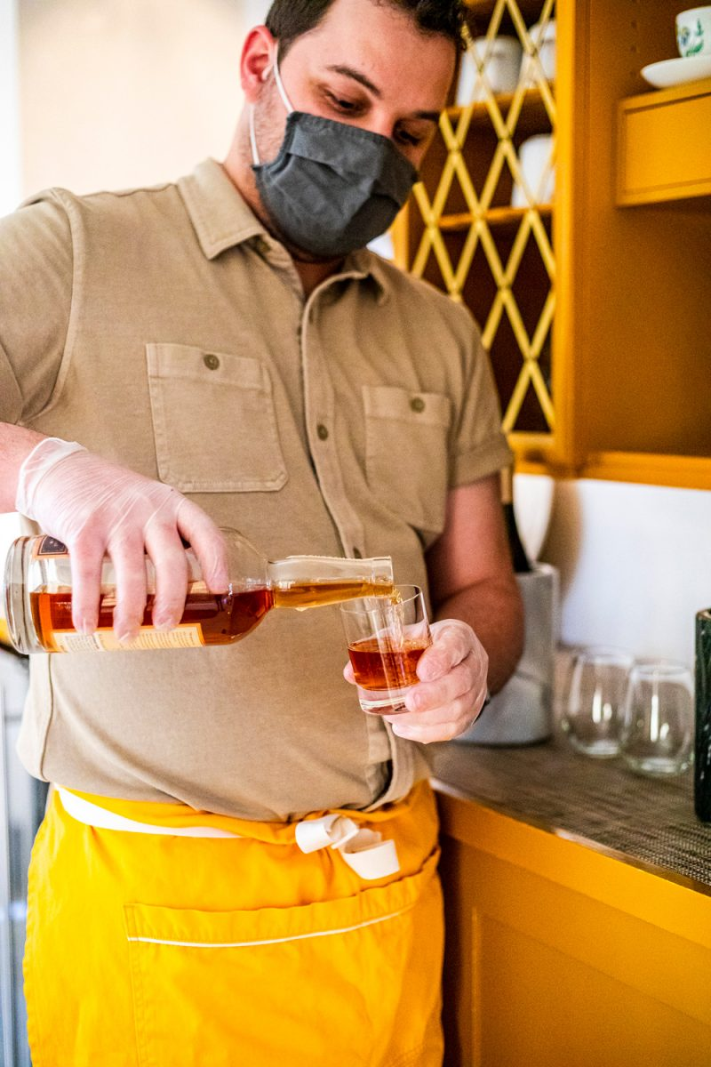 White Moose Inn Washington VA |Washington VA by popular D.C. travel blogger, Alicia Tenise: image of a man pouring a alcoholic drink.