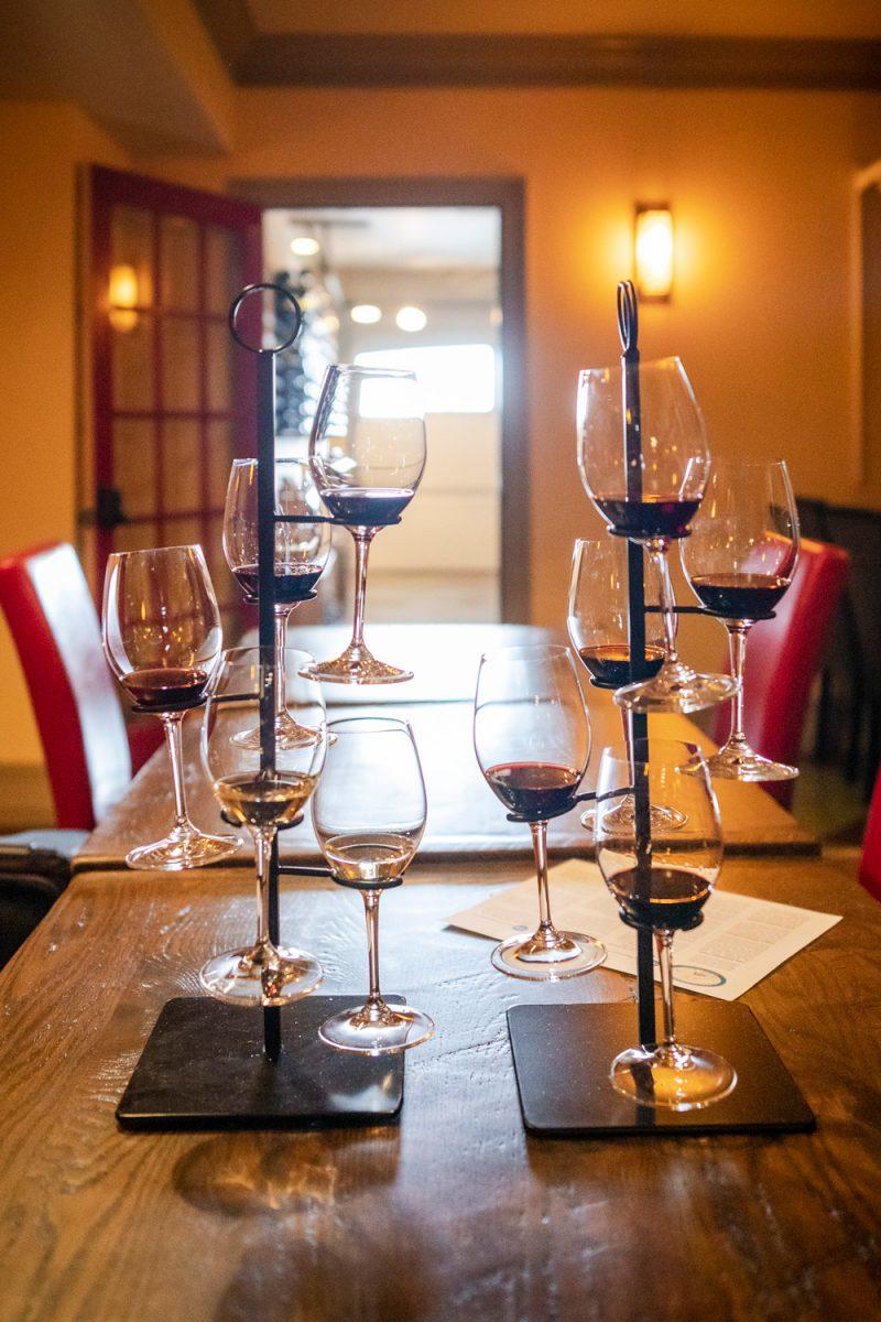 Little Washington Winery |Washington VA by popular D.C. travel blogger, Alicia Tenise: image of glasses of red and white wine at Little Washington winery.