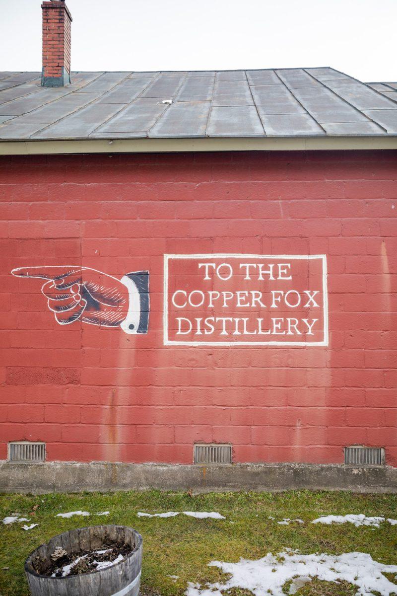 Copper Fox Distillery in Sperryville VA |Washington VA by popular D.C. travel blogger, Alicia Tenise: image of a Coper Fox Distillery sign.
