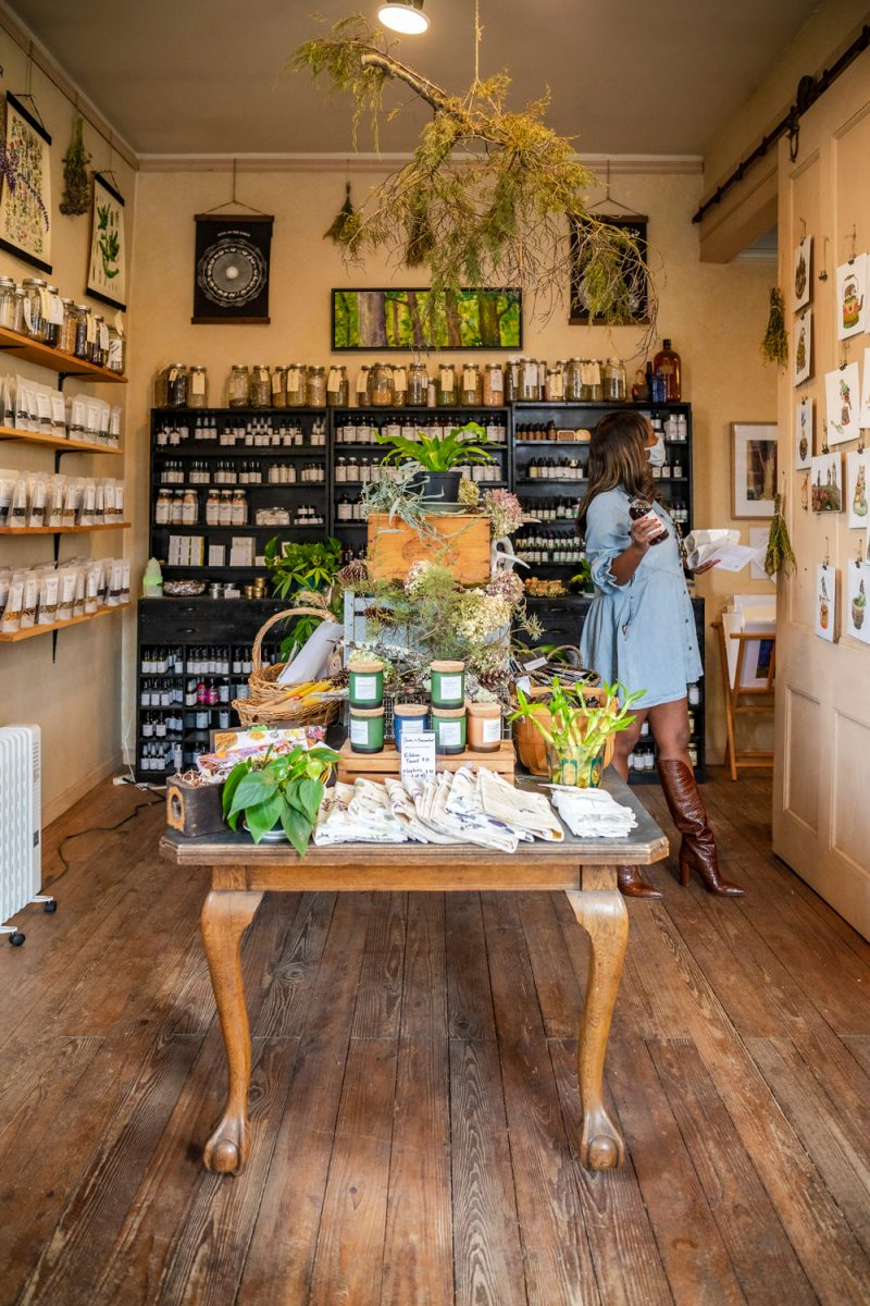 Wild Roots Apothecary in Sperryville VA |Washington VA by popular D.C. travel blogger, Alicia Tenise: image of Alicia Tenise shopping at Wild Roots Apothecary.