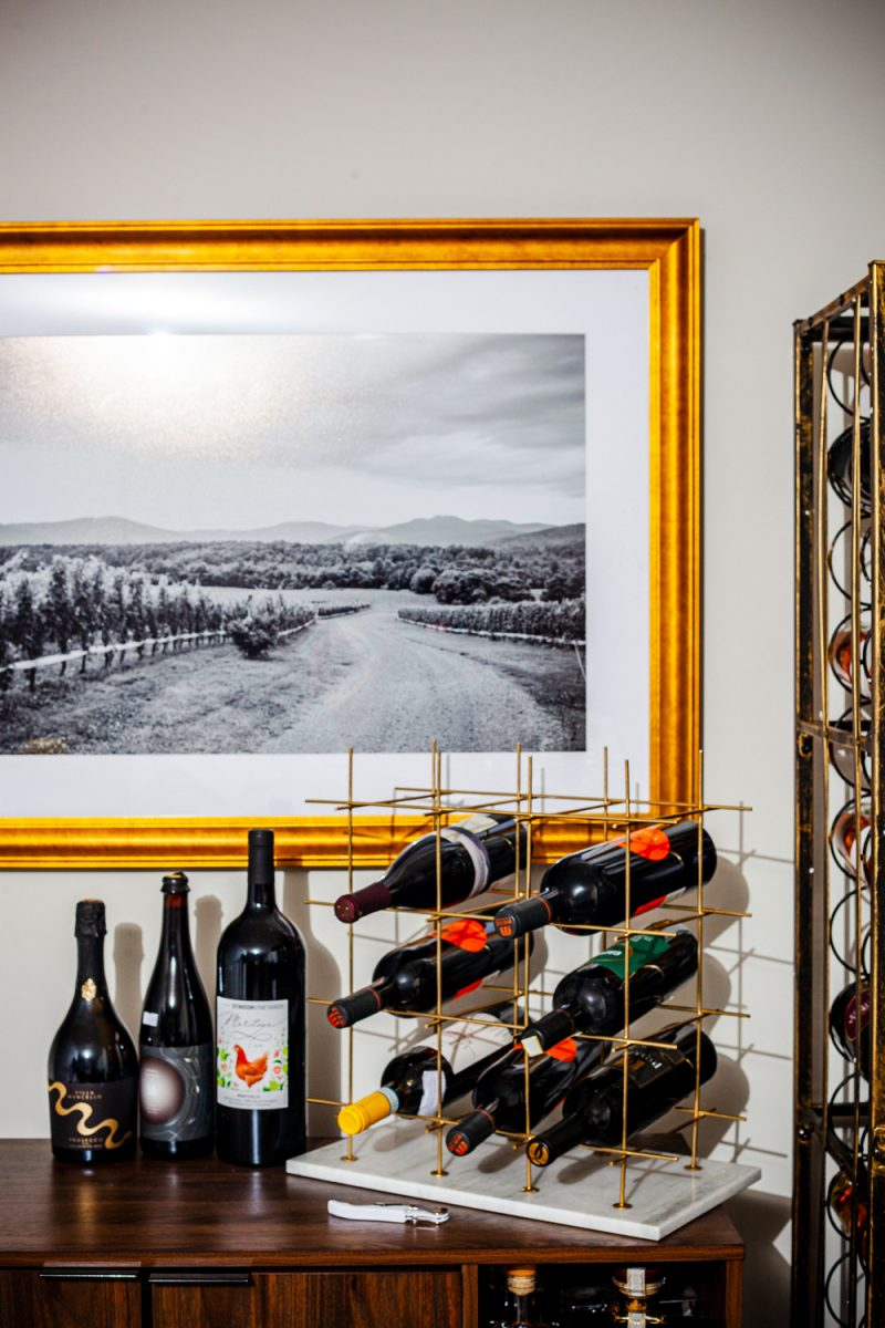 At Home Wine Cellar ideas featured by top VA lifestyle blogger, Alicia Tenise: Grayson Lane 12-Bottle Gold Metal Wine Rack |Lowe's Home Wine Cellar by popular D.C. lifestyle blogger, Alicia Tenise: image of wine cellar with a Lowe's Steel Metal Wine Rack, Lowe's Wine Cabinet, Lowe's 29-Bottle Wine Chiller, Lowe's Round Bar Table, Lowe's Bar Stools, Lowe's LED Light Strips, Lowe's Wall-Mounted Wine Rack, Lowe's Wood Wine Rack, and Lowe's Gold Metal Rectangular Wine Rack.