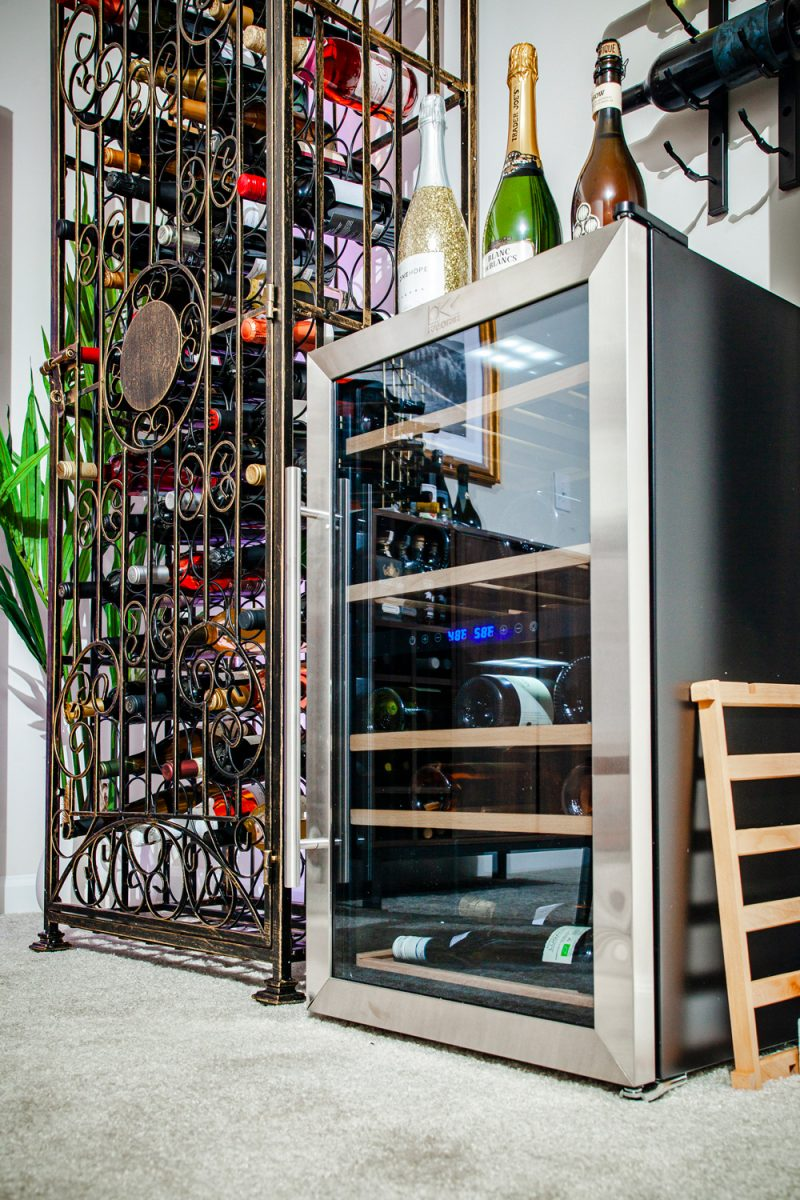 At Home Wine Cellar ideas featured by top VA lifestyle blogger, Alicia Tenise: Kalorik 29-Bottle Capacity Black, Stainless Steel Dual Zone Cooling Freestanding Wine Chiller |Lowe's Home Wine Cellar by popular D.C. lifestyle blogger, Alicia Tenise: image of wine cellar with a Lowe's Steel Metal Wine Rack, Lowe's Wine Cabinet, Lowe's 29-Bottle Wine Chiller, Lowe's Round Bar Table, Lowe's Bar Stools, Lowe's LED Light Strips, Lowe's Wall-Mounted Wine Rack, Lowe's Wood Wine Rack, and Lowe's Gold Metal Rectangular Wine Rack.