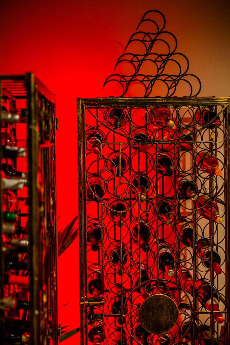 At Home Wine Cellar ideas featured by top VA lifestyle blogger, Alicia Tenise: Wine Enthusiast 96-Bottle Steel Metal Wine Rack |Lowe's Home Wine Cellar by popular D.C. lifestyle blogger, Alicia Tenise: image of wine cellar with a Lowe's 96 bottle wine rack.