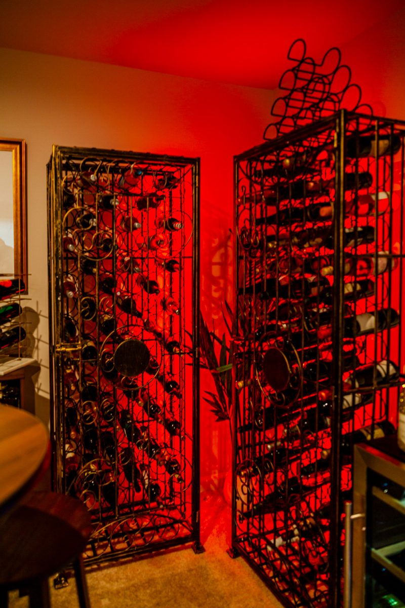 At Home Wine Cellar ideas featured by top VA lifestyle blogger, Alicia Tenise |Lowe's Home Wine Cellar by popular D.C. lifestyle blogger, Alicia Tenise: image of wine cellar with a Lowe's Steel Metal Wine Rack, Lowe's Wine Cabinet, Lowe's 29-Bottle Wine Chiller, Lowe's Round Bar Table, Lowe's Bar Stools, Lowe's LED Light Strips, Lowe's Wall-Mounted Wine Rack, Lowe's Wood Wine Rack, and Lowe's Gold Metal Rectangular Wine Rack.