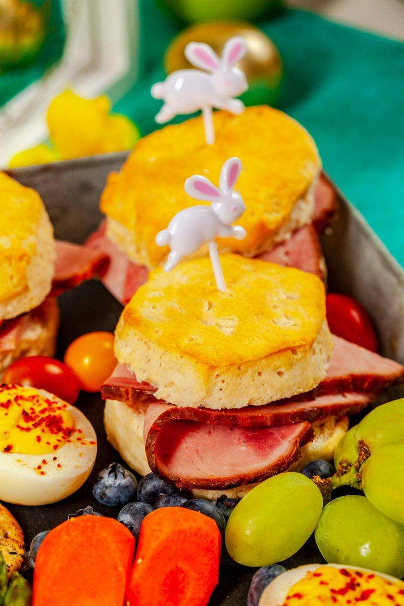 Easter charcuterie board ideas featured by top US lifestyle blogger, Alicia Tenise - Ham Biscuits