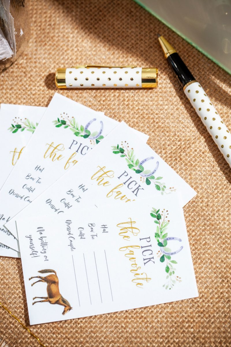 Kentucky Derby Party essentials featured by top US lifestyle blogger, Alicia Tenise |Kentucky Derby Party by popular D.C. lifestyle blogger, Alicia Tenise: image of pick the favorite voting cards next to a white and gold dot pen.