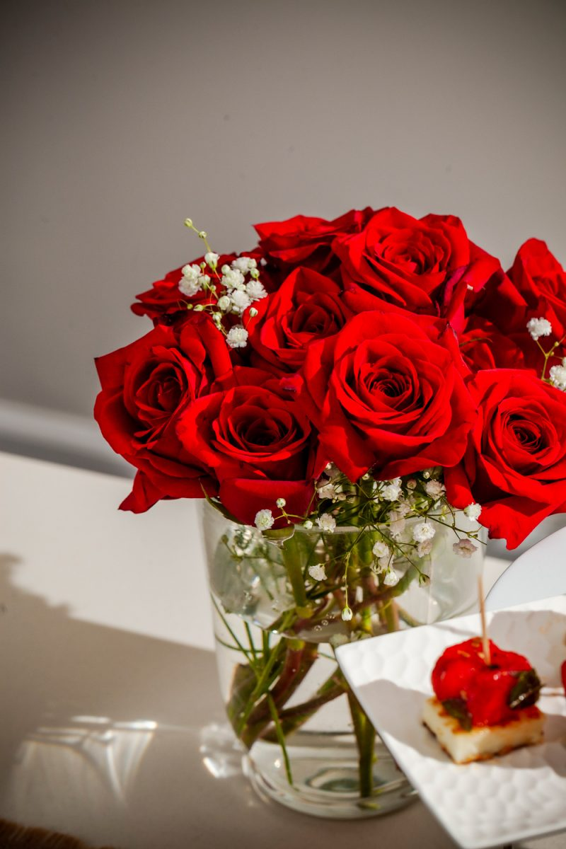 Kentucky Derby Party essentials featured by top US lifestyle blogger, Alicia Tenise - Kentucky Derby Roses |Kentucky Derby Party by popular D.C. lifestyle blogger, Alicia Tenise: image of a vase of red roses.