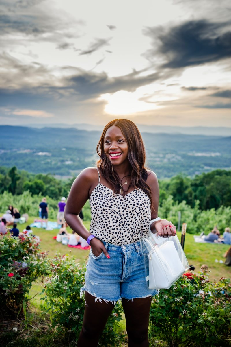 AGOLDE Dee Shorts | Best Summer Shorts by popular DC fashion blogger, Alicia Tenise: image of Alicia Tenise wearing a pair of AGolde dee shorts with a black and white polka dot tank and holding a clear handbag.
