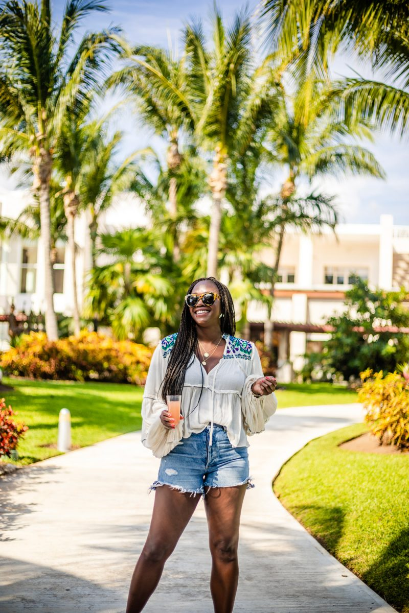 Best Summer Shorts by popular DC fashion blogger, Alicia Tenise: image of Alicia Tenise wearing a pair of Madewell denim shorts with a peasant blouse.