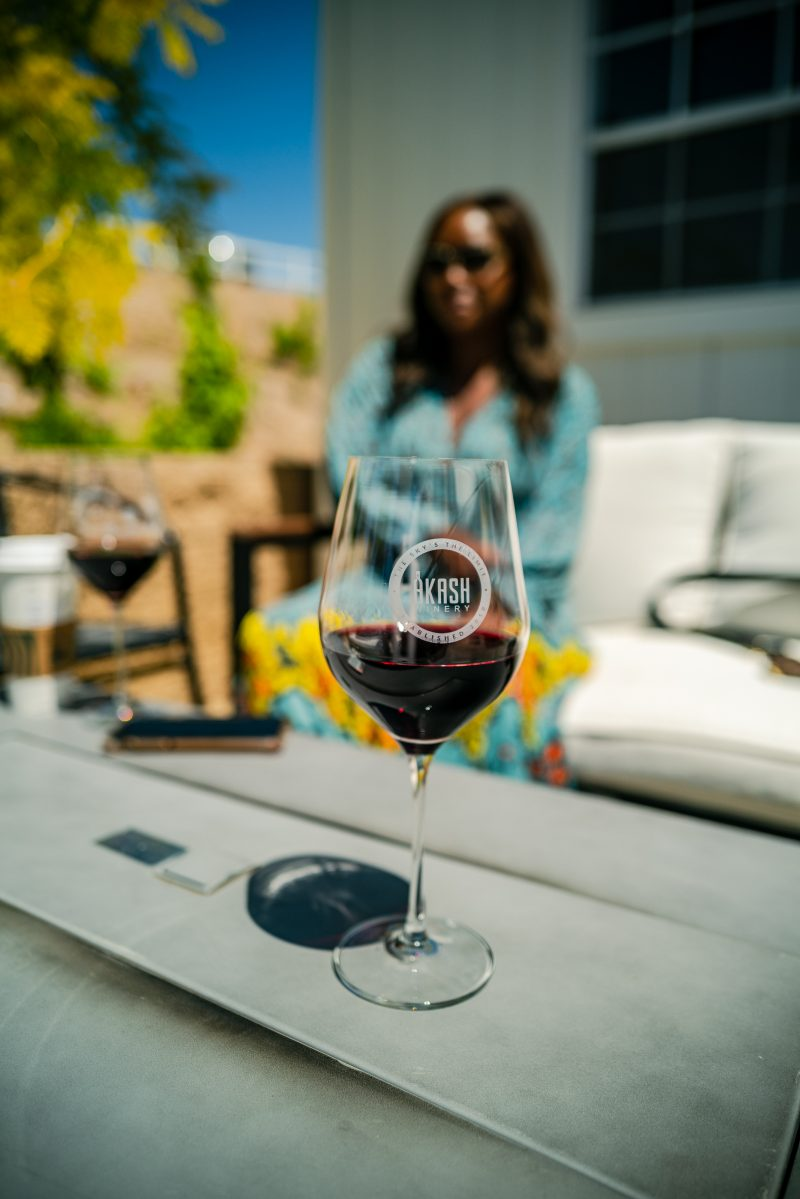 3 Wineries to Visit in the Northern San Diego Area for the Red Wine Lover featured by top LA travel blogger, Alicia Tenise: Akash Winery | San Diego Wineries by popular LA lifestyle blogger, Alicia Tenise: image of some red wine in a Akash Vineyard wine glass.